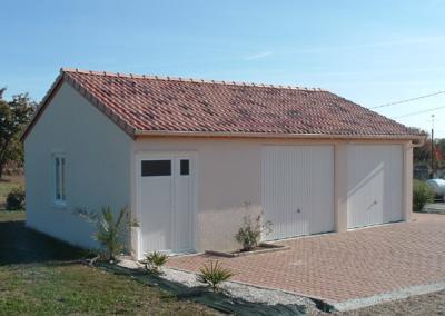 Double garage avec abri de jardin en béton