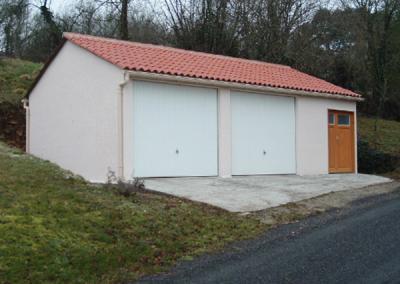 Garage double béton à 2 pentes avec abri de jardin