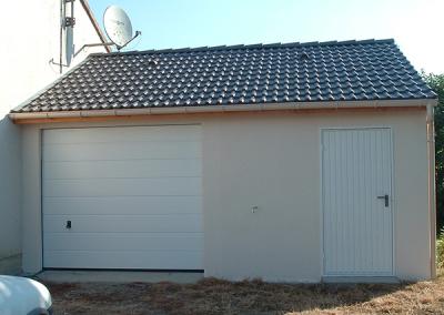 Garage simple en béton avec abri et 1 porte